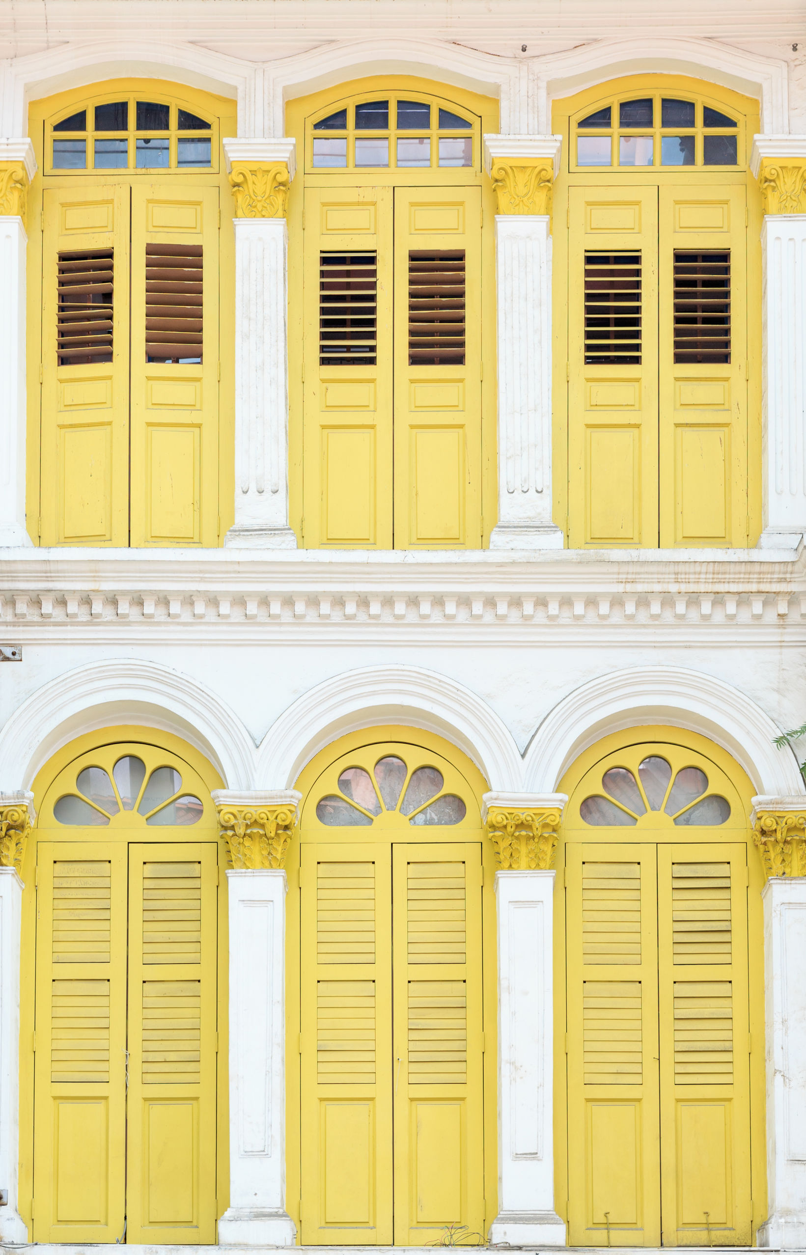 White building and wellow windows from singapore.
